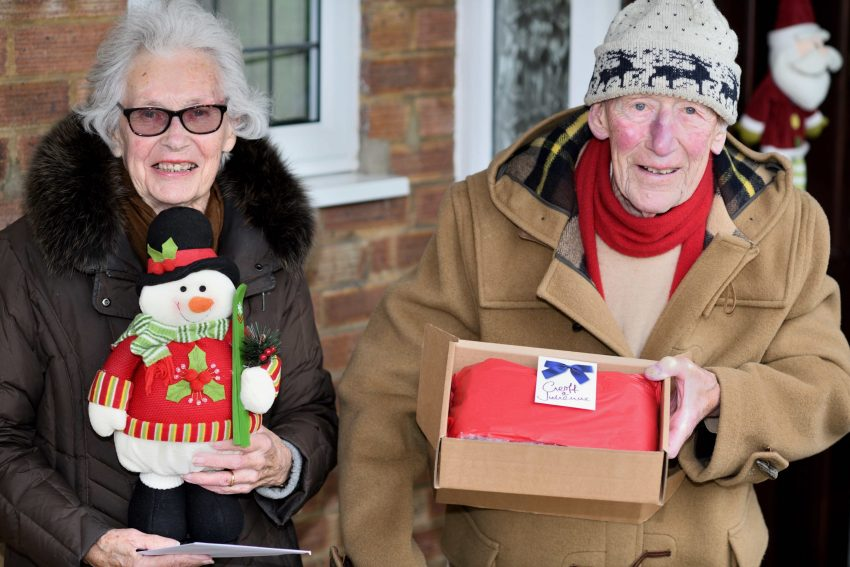 Geoffrey and Jullienne Pulzer recive their Taxi Charity Christmas Stocking