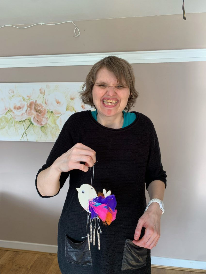 Cabrini House Resident Nicola with an Easter chick