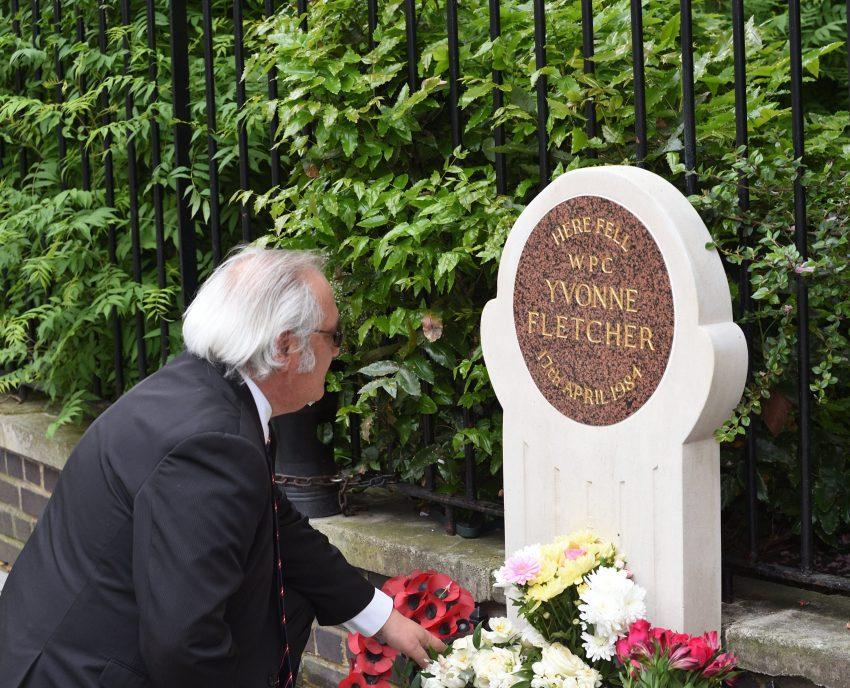 John Murray lays flowers for WPC Yvonne Fletcher